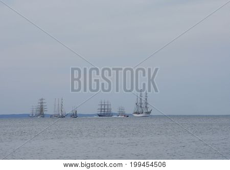 flowing on sea sailing-ship on sky background