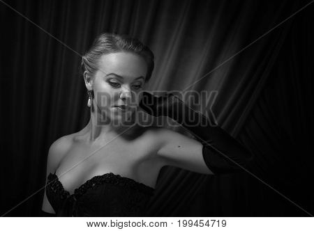 Young Beautiful Woman In Black With Pearl Earrings.