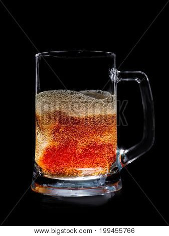 Glass Illuminated Pint Of Beer With Bubbles.