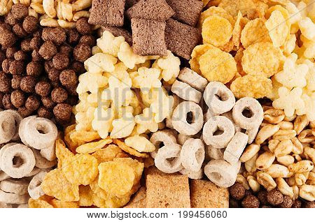 Corn flakes set - rings balls stars pads chocolate golden as decorative cereals background.