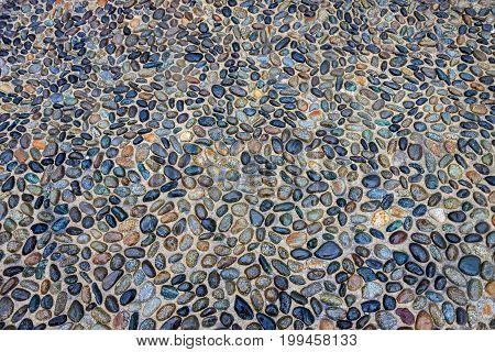 Cobblestone pavement in small pebbles in Milan