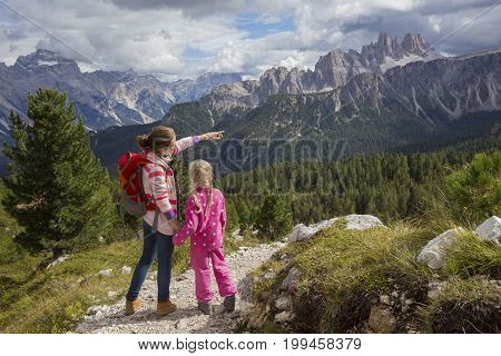 Two Tourist Girls At The Dolomites