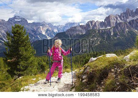 Little Girl Hiker On A Path