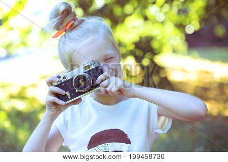 Little Pretty Girl With Retro Camera