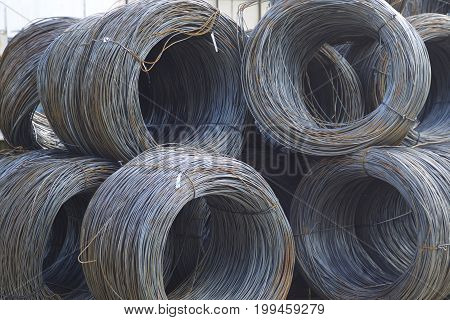 Thin metal reinforcement with corrugation wound into bays at the metal products warehouse Russia