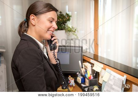 Professional Receptionist Answering To A Phone Call
