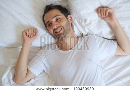 Cheerful Man Lying In His Bed In The Morning