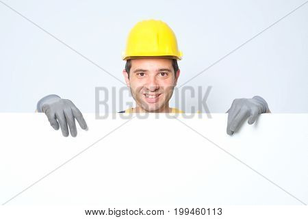 Worker holding a copy space cardboard for text advertisement