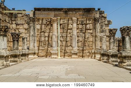 Archaeological site Capernaum, ancient ruins of synagogue of white calcareous stone, on the shore of the Sea of Galilee in Israel