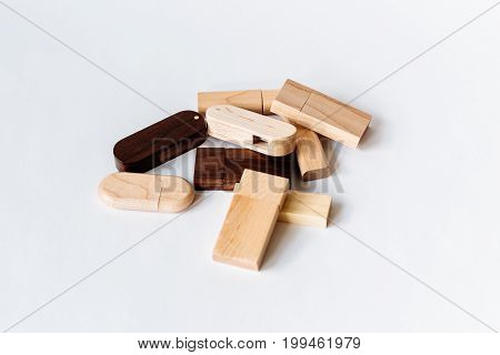 Wooden Usb Flash Drives On White Background. Copy Space