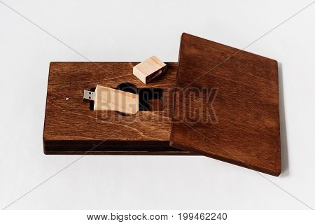 Packaging For Usb Drive. Dark Wooden Box With Usb-storage For A Photographer, On A White Isolated Ba