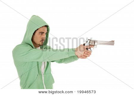 Man In Green With Gun Point