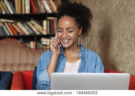 Cute Adorable Mixed-race Female Student With Curly Hair Having Nice Phone Conversation, Working On D