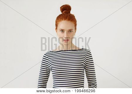Cute Girl With Pleasant Features, Ginger Hair Tied In Knot, Dressed Casually, Looking With Slightly