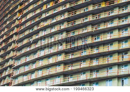 Pattern Of Windows In Condominium Room With Attached Small Balcony