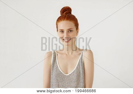Positive Young Girl With Ginger Hair Knot, Wearing Loose Sailor Shirt, Having Charming Smile, Isolat