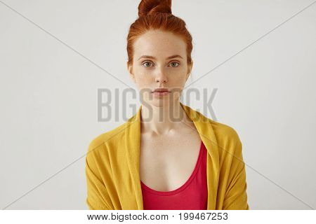 Headshot Of Confident Young Female Model With Reddish Hair, Freckled Skin And Charming Eyes, Wearing
