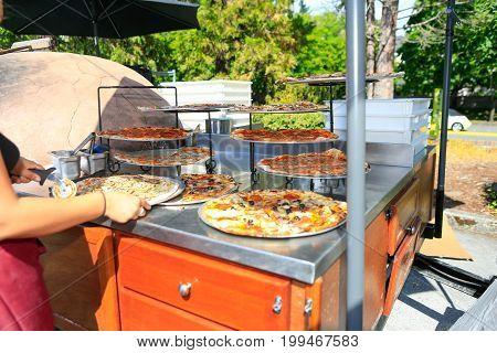 Preparing Organic Pizza At The Farmers' Market