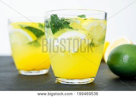 Cold and refreshing lemonade with lemon and limes. Fresh lemonade