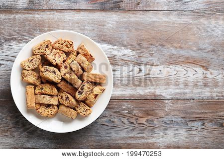 Cantuccini Cookies In Plate On Brown Wooden Table