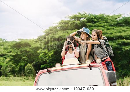 Happy Asian women friends backpacker enjoy nature during vacation travel trip in forest.