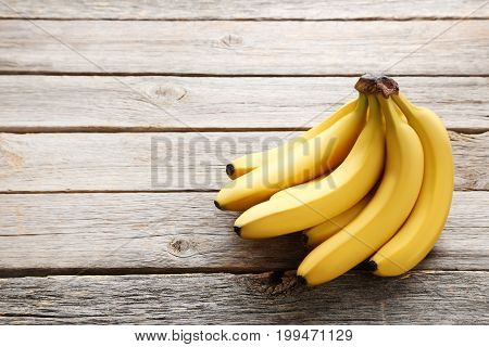Sweet bananas on the grey wooden table