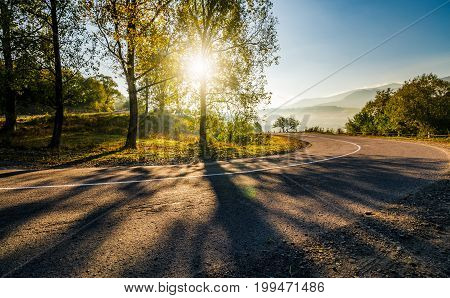 Mountainous Countryside Road At Sunrise
