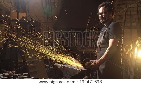 Sparks during cutting of metal angle grinder. Worker using industrial grinder