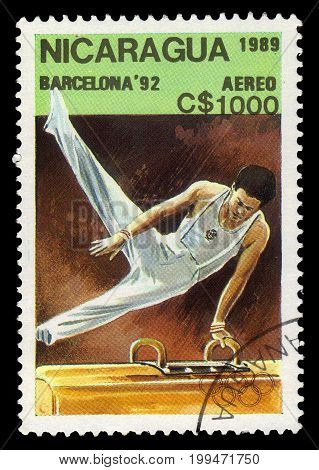 Nicaragua - circa 1989: A stamp printed in Nicaragua shows pommel horse (also side horse), artistic gymnastics, Olympic Games 1992 - Barcelona, circa 1989