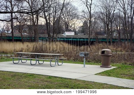 SHOREWOOD, ILLINOIS / UNITED STATES - DECEMBER 6, 2015: Picnickers may sit at a picnic table in the Hammel Woods Forest Preserve in Shorewood, Illinois.