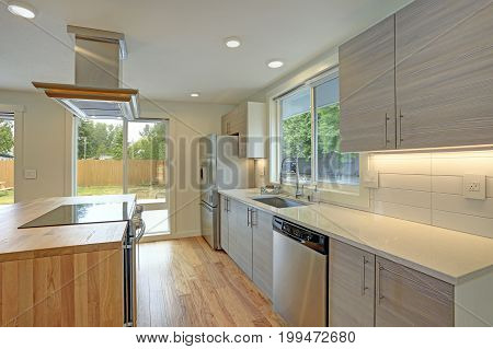 Newly Remodeled Kitchen Boasts Kitchen Island With A Hood.