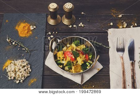 Healthy vegetarian food. Indian restaurant dish with fried tofu cheese, broccoli, mung bean and spices, top view, flat lay