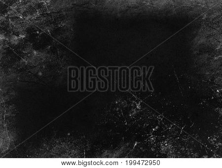Black gray background of school blackboard monochrome texture. Vignetted aged texture background.