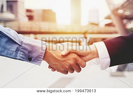 successful business people handshaking closing a deal , business team partnership concept .