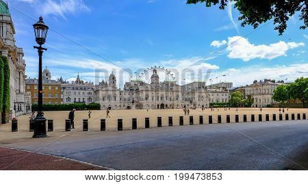 Horseguard's Parade London UK - July 21 2017: wide angle view of Horseguard's Parade ground wth tourists wandering around on a bright sunny summer day.