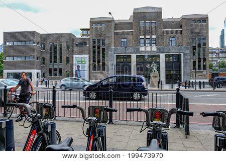 Poplar London UK - July 16 2017: Poplar Baths regenerated looking from Chrisp Street through bicyle handle bars.