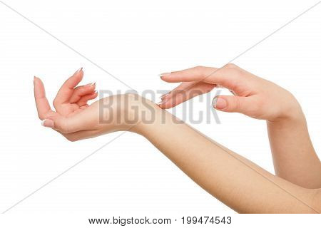 Female hands with french manicure isolated on white background. Beauty and skincare concept, close-up, cutout