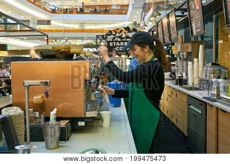 SAINT PETERSBURG, RUSSIA - CIRCA AUGUST, 2017: worker at Starbucks coffee shop in Saint Petersburg. Starbucks Corporation is an American coffee company and coffeehouse chain.