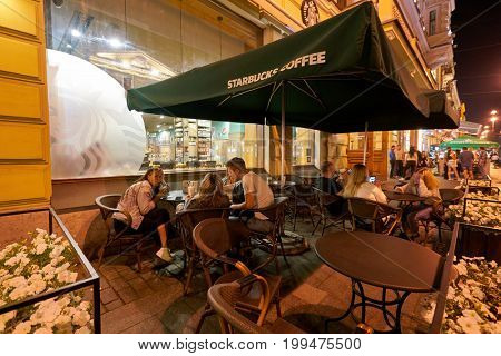 SAINT PETERSBURG, RUSSIA - CIRCA AUGUST, 2017: people at Starbucks coffee shop in Saint Petersburg. Starbucks Corporation is an American coffee company and coffeehouse chain.