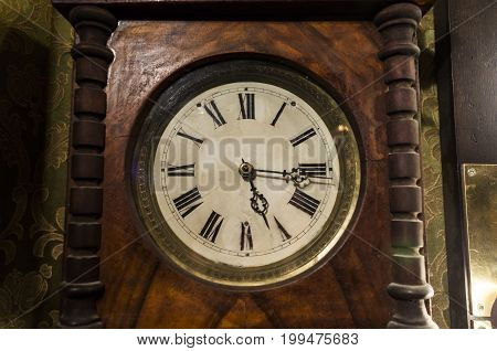 Antique Wooden Clock With Roman Numerals