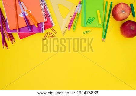 back to school styed scene border with school supplies on yellow