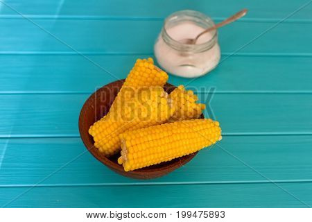 Boiled corn on a blue wood background