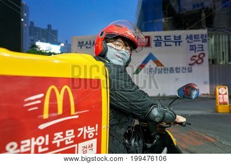BUSAN, SOUTH KOREA - CIRCA MAY, 2017: McDonald's delivery in Busan. McDonald's is an American hamburger and fast food restaurant chain.