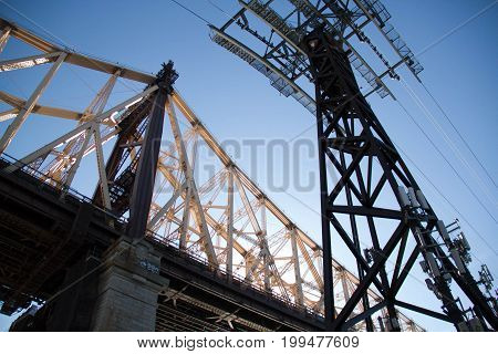 Queensboro bridge and tram cable with blue sky
