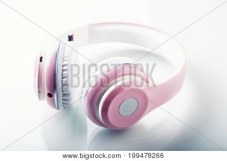 Headphones. Pink Headphones With Jack Connector - Mirror Reflection