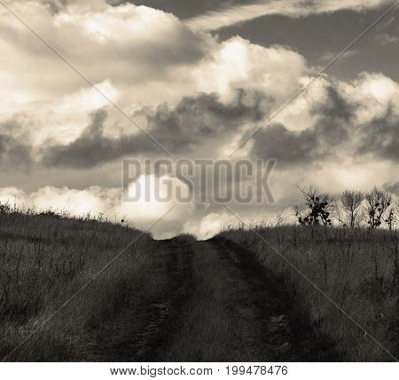 The black-and-white image of the road of the leader into the sky. Clouds hang over the top of this road and having climbed it it is possible to get on a cloud.