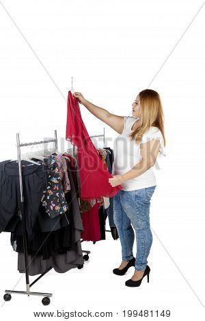 Portrait of a young overweight woman choosing clothes to buy isolated on white background