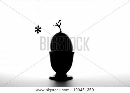 macro of miniature figure skater on eggs