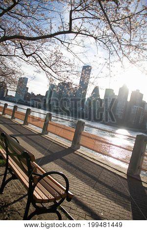 Walkway at Roosevelt island opposite Manhattan with sunlight