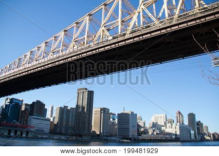 Queensboro bridge over East river and Manhattan with clearly blue sky